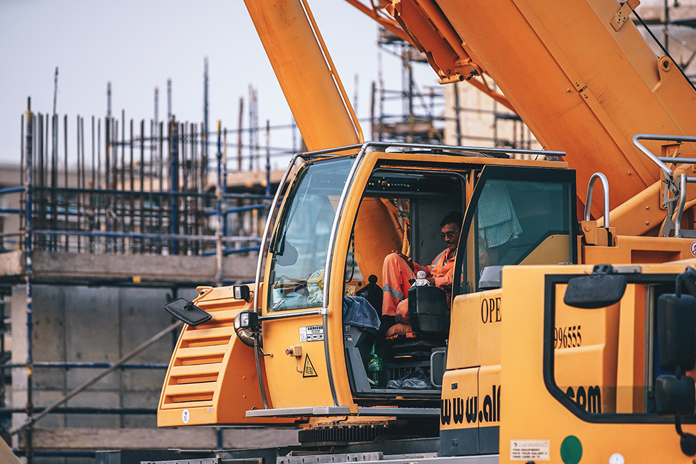 Construction worker in heavy machinery