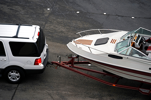 Car with a boat trailer